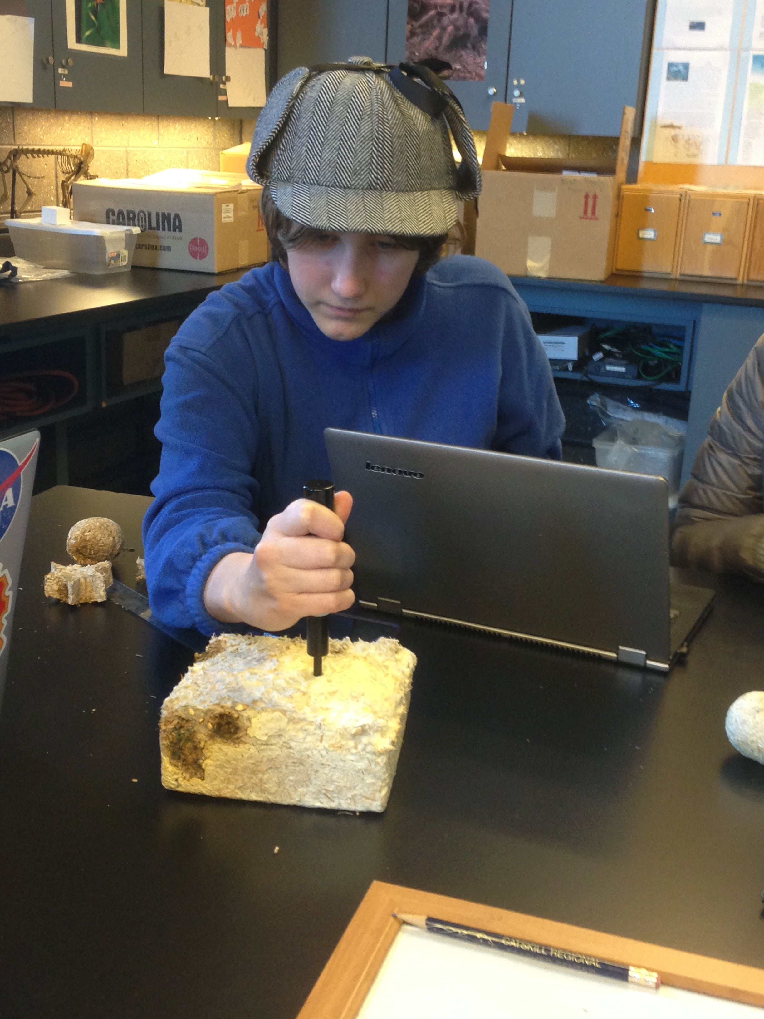 Student testing grown GIY block.